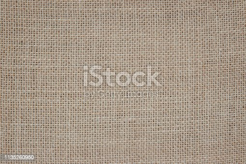 1044099896 istock photo Vintage abstract Hessian or sackcloth fabric or hemp sack texture background. Wallpaper of artistic wale linen canvas. 1135260950