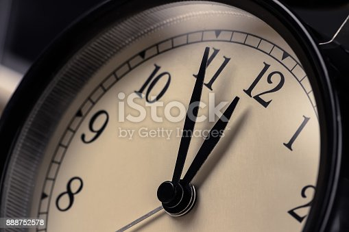 istock vintage alarm clock is showing midday or midnight movement. It is twelve o'clock, holiday happy new year festive and christmas or lunch 888752578