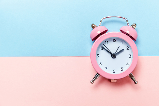 1035679160 istock photo Vintage alarm clock Isolated on blue and pink pastel background 1136902116