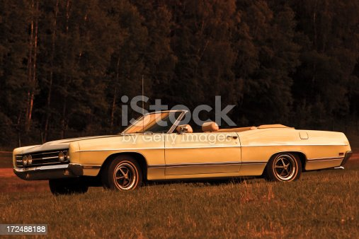 US classic convertible car in warm sunset light,