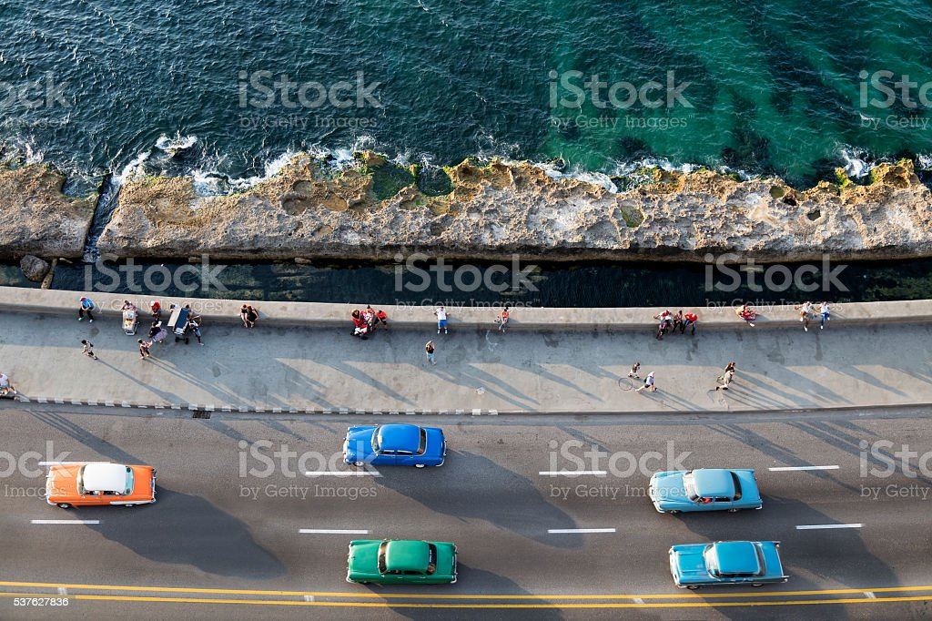 Vintage American Cars Speeding along the Malecon in Havana, Cuba stock photo