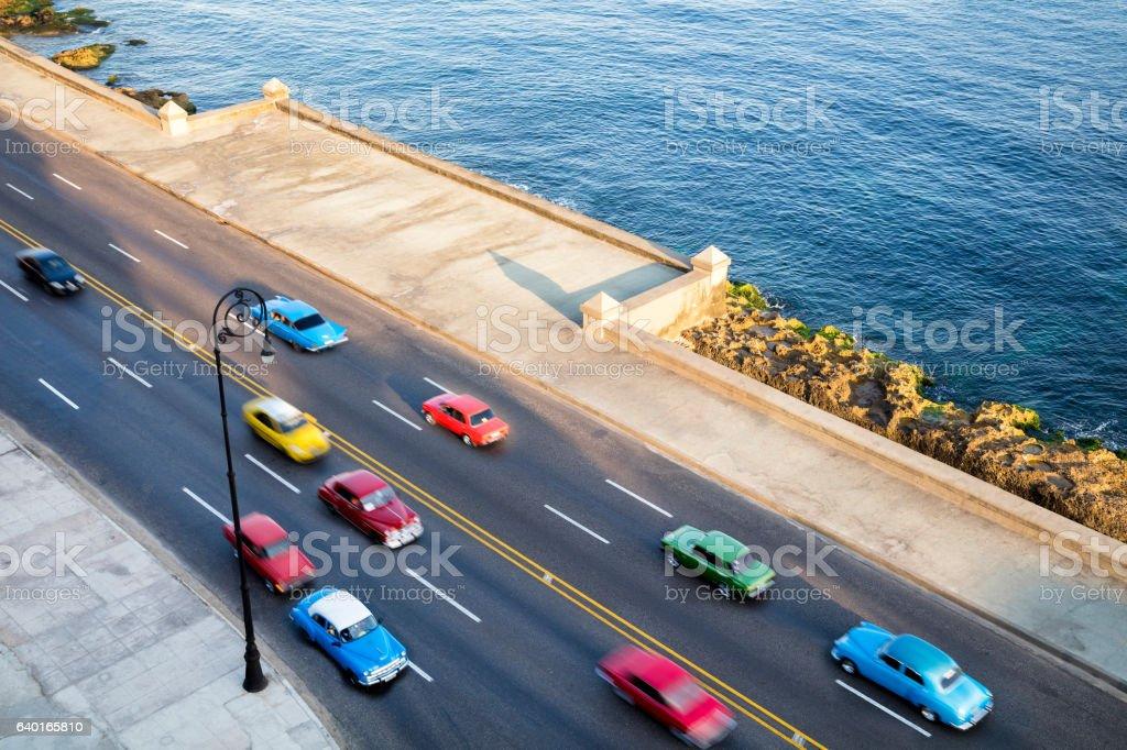 Vintage American Cars Speeding along the Malecon in Havana, Cuba stock photo