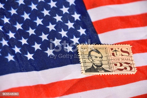 Vintage American Stamp On top of the United States flag