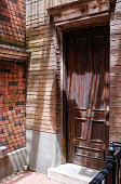 vintage American style red brick building wood gate