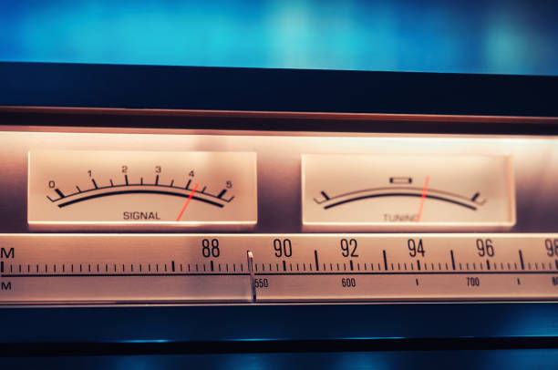 Vintage amplifier tuner scale with VU meters close up shot stock photo