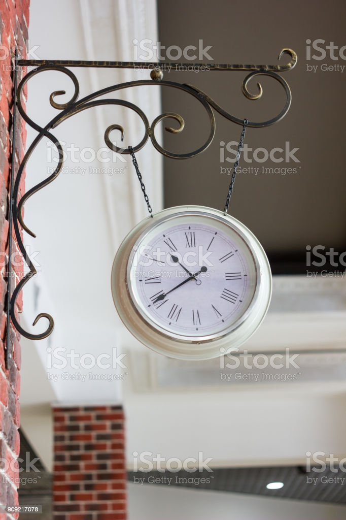 Vintage analog clock on street of Russia. stock photo