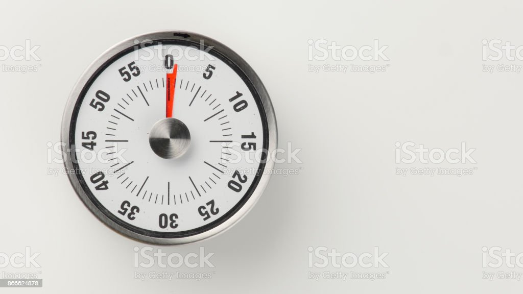 Vintage analog kitchen countdown timer, 1 minute remaining stock photo
