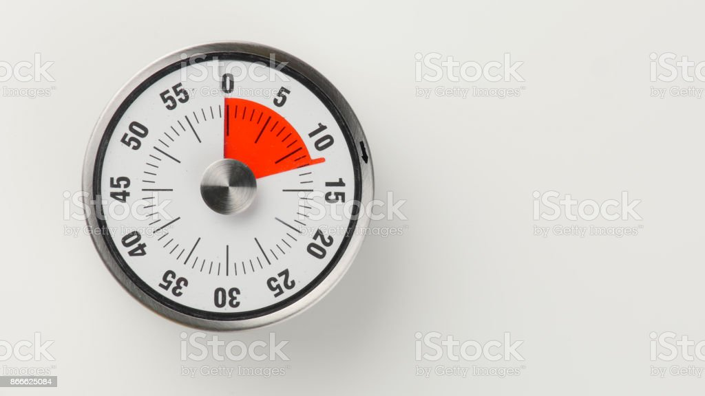 Vintage analog kitchen countdown timer, 12 minutes remaining stock photo