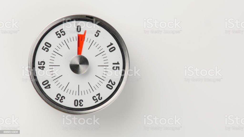 Vintage analog kitchen countdown timer, 2 minutes remaining stock photo