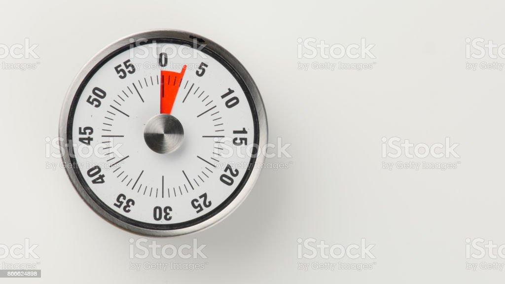Vintage analog kitchen countdown timer, 3 minutes remaining stock photo
