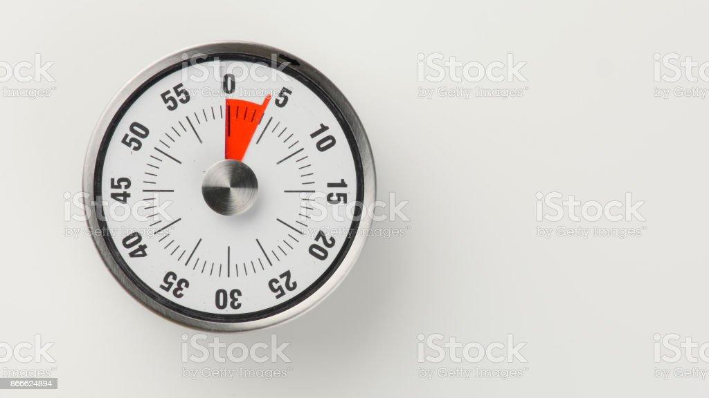 Vintage analog kitchen countdown timer, 4 minutes remaining stock photo