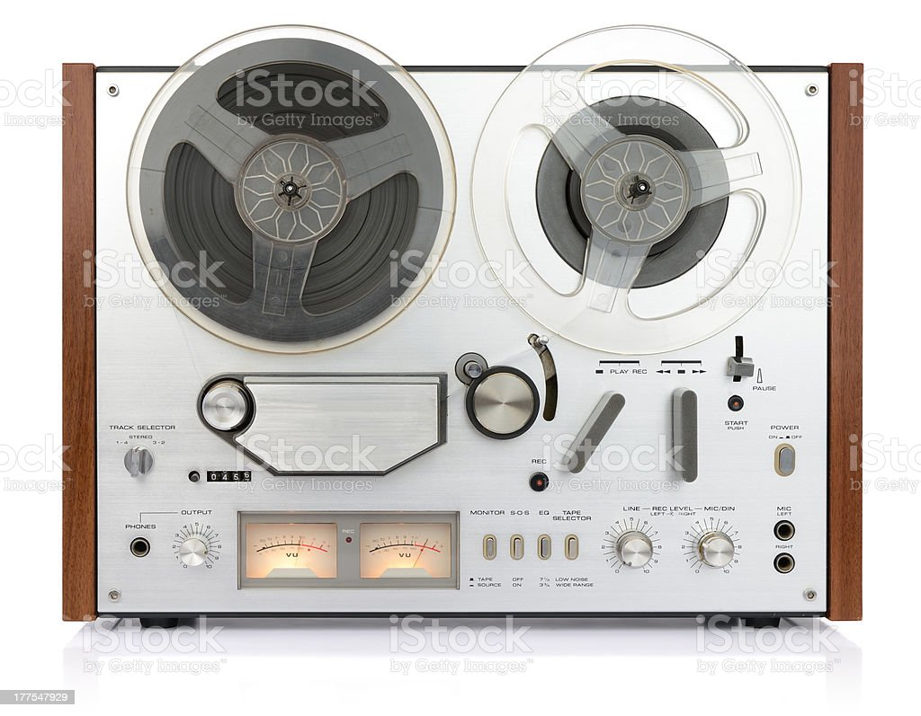 vintage analog recorder tape on white background, isolated path included stock photo