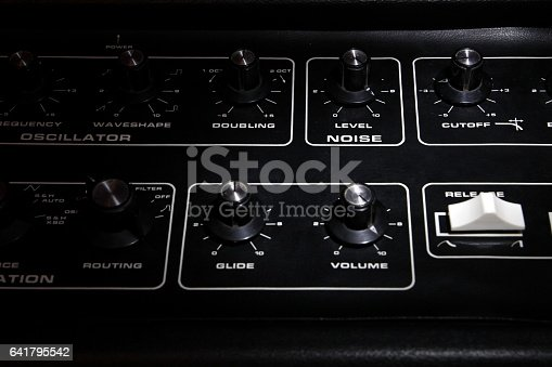 istock Vintage analogue synth control panel closeup in shallow focus 641795542