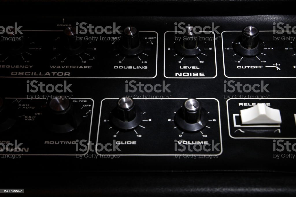 Vintage analogue synth control panel closeup in shallow focus stock photo