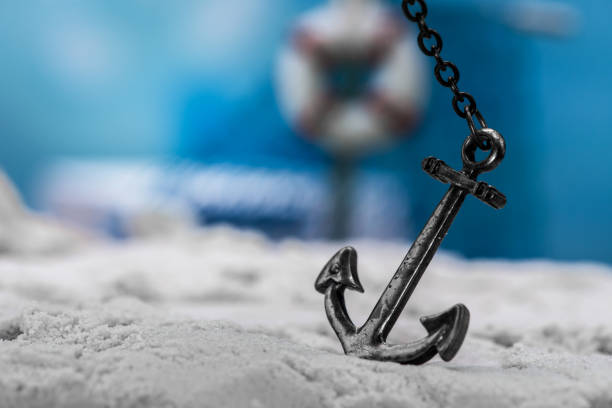vintage anchor on the beach vintage anchor on the beach anchor athlete stock pictures, royalty-free photos & images