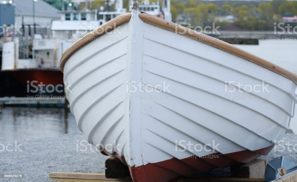 Vintage and beautiful wooden rowboat completely painted and restored ready for sea stock photo