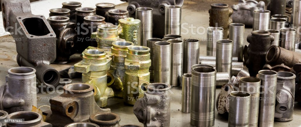 Vintage antique automotive machine shop stainless steel sleeved hydraulic cylinders and tubing assortment stock photo