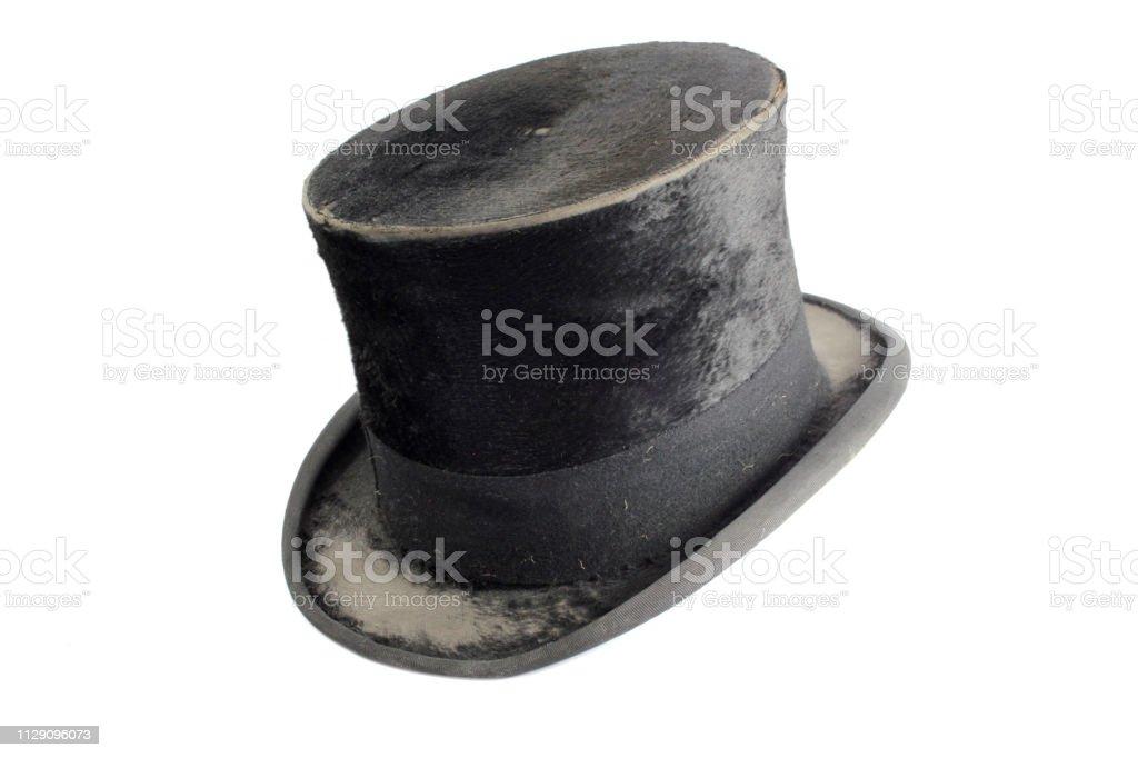 Vintage Antique Black Top Hat on White Background stock photo