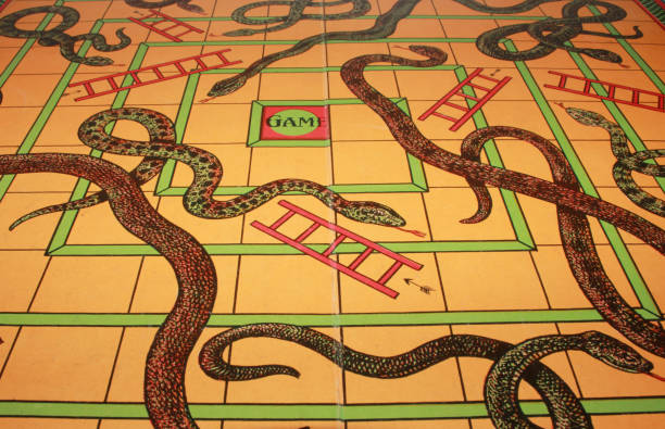 Vintage Antique Snakes and Ladders Board Game stock photo