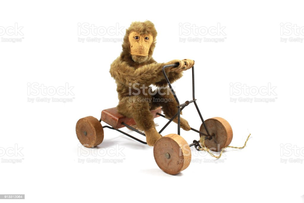 Vintage Antique Toy Teddy Monkey On Tricycle On White Background