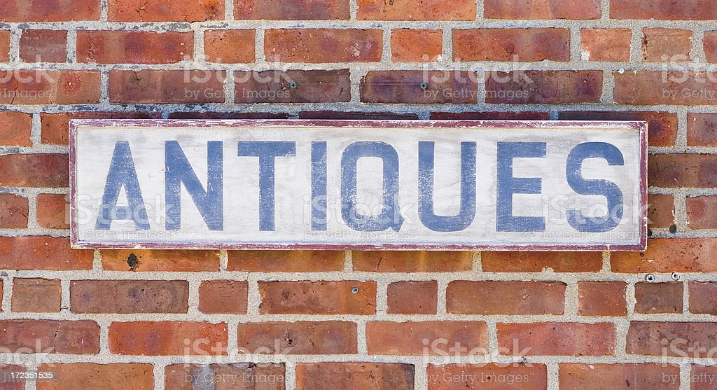 Vintage Antiques Sign on Brick Wall royalty-free stock photo