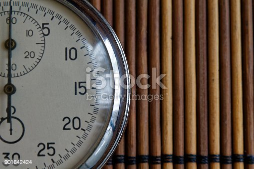 istock Vintage antiques Stopwatch, retro on wooden background, value measure time old clock arrow minute second accuracy timer record 901642424