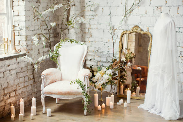 vintage armchair near candles, mirror and wedding dress - home decor boho imagens e fotografias de stock