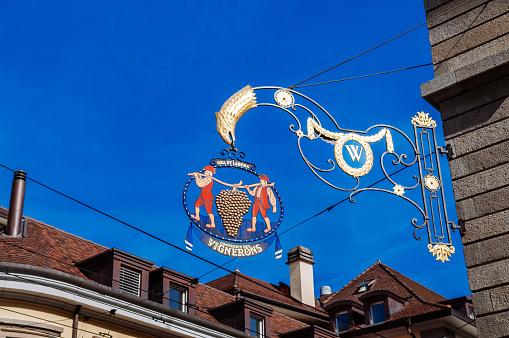 vintage artisan wine restaurant iron sign hanging on building wall