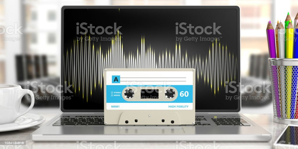 Vintage audio cassette, on a computer, blur office business...