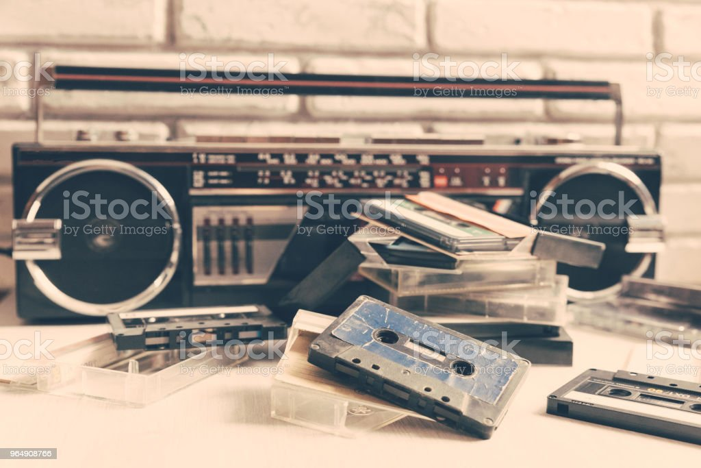 Vintage audio cassette on wooden background. royalty-free stock photo