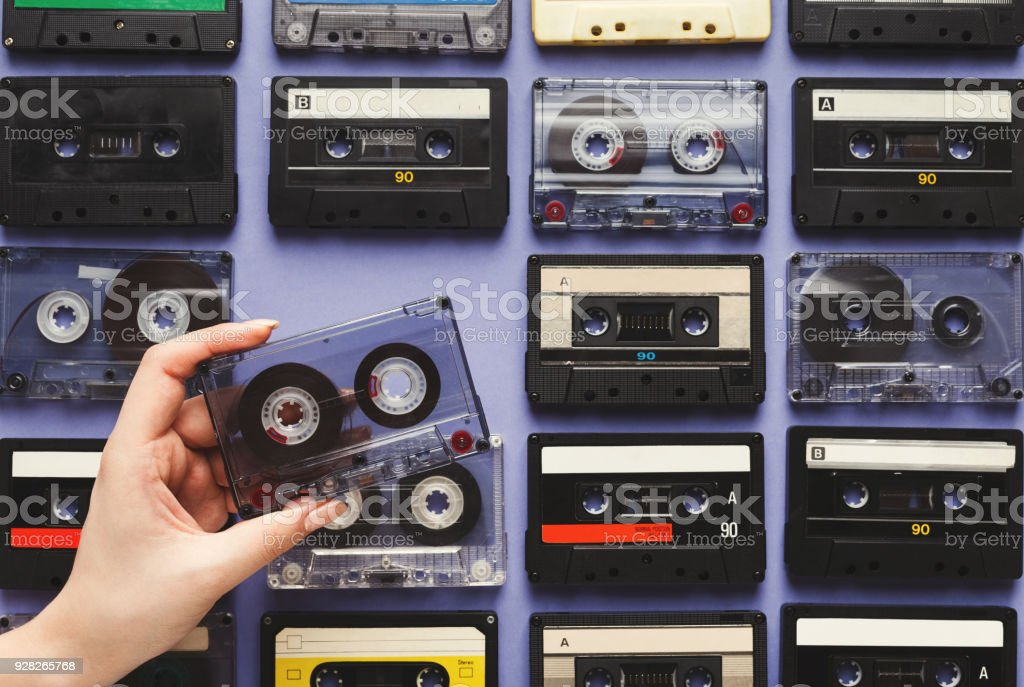 Retro audio cassette tapes on blue background. Top view on vintage...