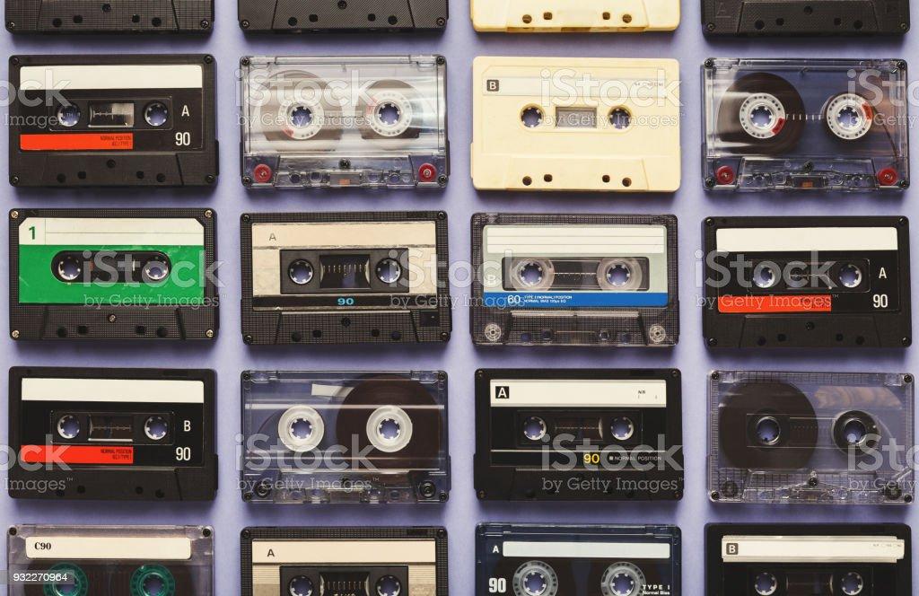 Vintage audio cassettes blue background stock photo