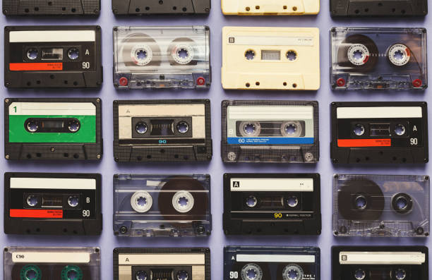 Vintage audio cassettes blue background Retro audio cassette tapes on blue background. Top view on vintage media devices, copy space on labels, flat lay audio cassette stock pictures, royalty-free photos & images