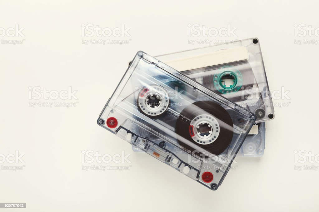Three retro audio cassette tapes isolated on white background. Top...