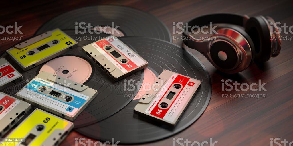 Vintage Audio Cassettes Vinyl Records And Dj Headphones Wooden Background  3d Illustration Stock Photo - Download Image Now