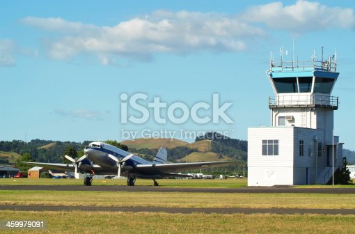 Vintage airplane and control tower in Ardmore, New Zealand.