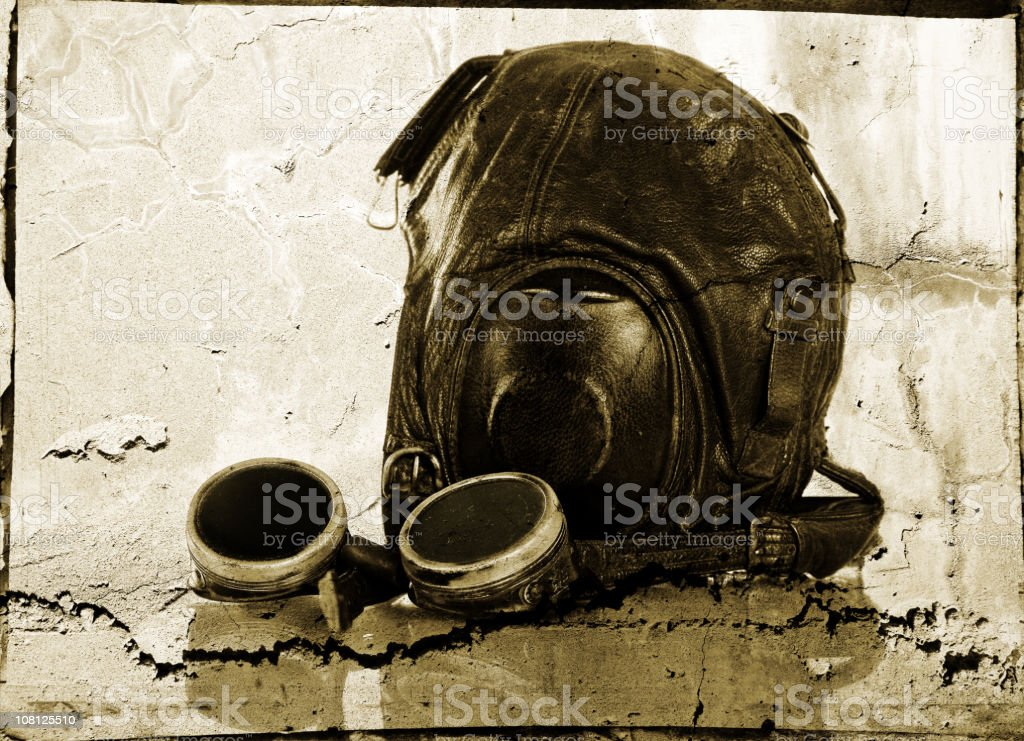 Grunge Camera Effect : Vintage aviator hat and flying goggles grunge effect stock photo