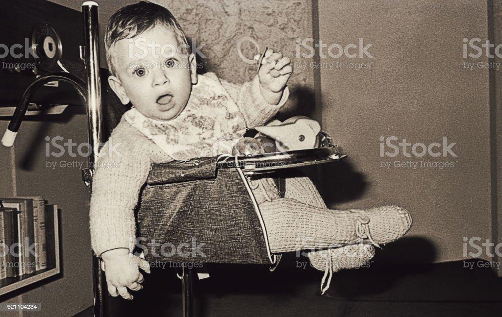 Vintage baby boy staring at camera stock photo