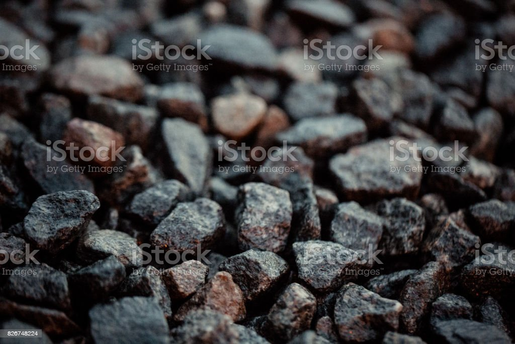 Vintage background of gravel. film grain. Texture of a wet road. One of a million. A special and outstanding object. Stand out from the crowd. A unique stone stock photo