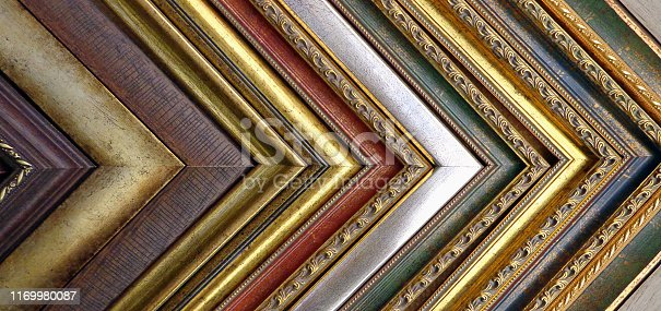 914465180 istock photo Vintage background of picture frames and baguettes. 1169980087