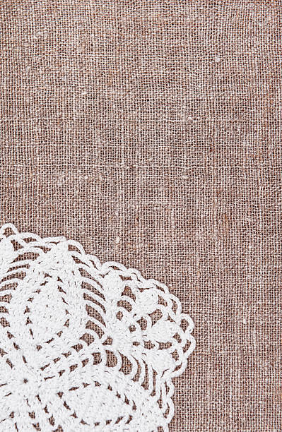 Vintage Background With Lace On The Old Burlap Stock Photo