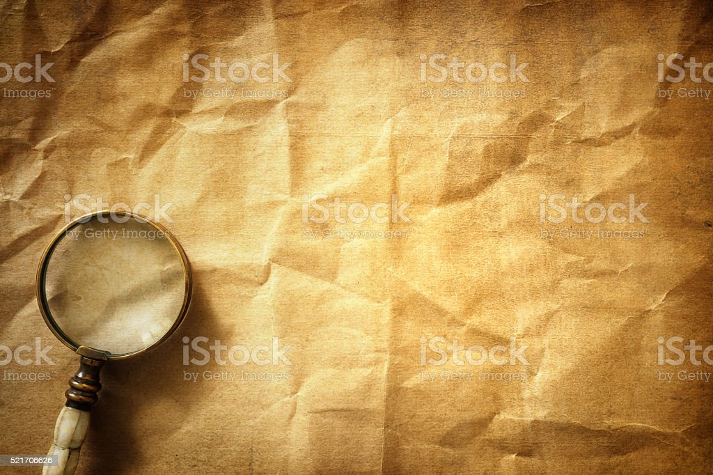 Vintage background with magnifying glass stock photo