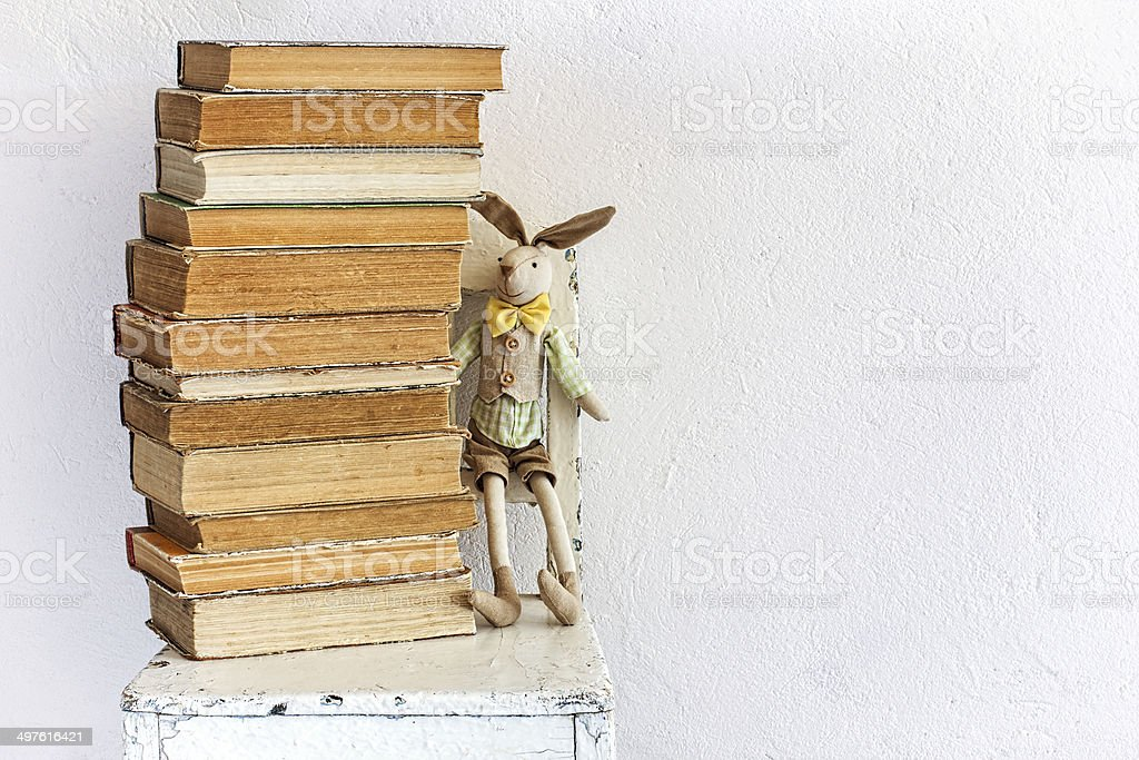 Vintage background with old books and bunny toy royalty-free stock photo