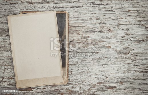 882302538 istock photo Vintage background with old photos on wood 862070330