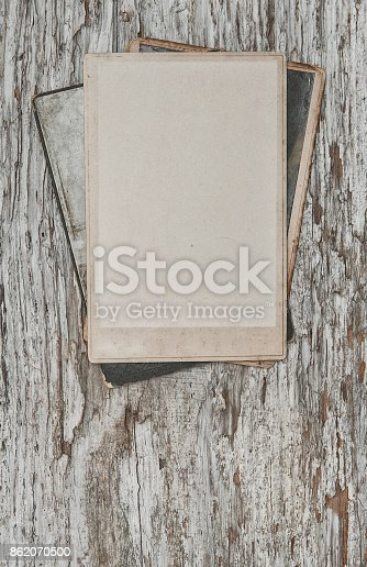 882302538 istock photo Vintage background with old photos on wood 862070500