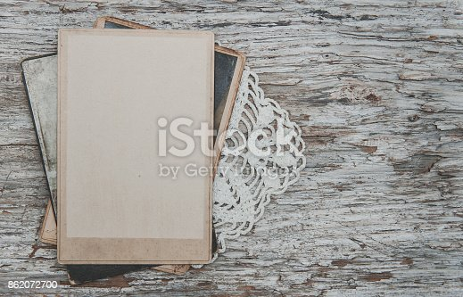 882302538 istock photo Vintage background with old photos on wood with lace 862072700