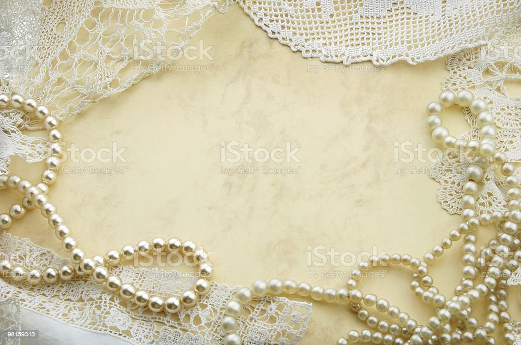 Vintage background with pearls and old doilies royalty-free stock photo