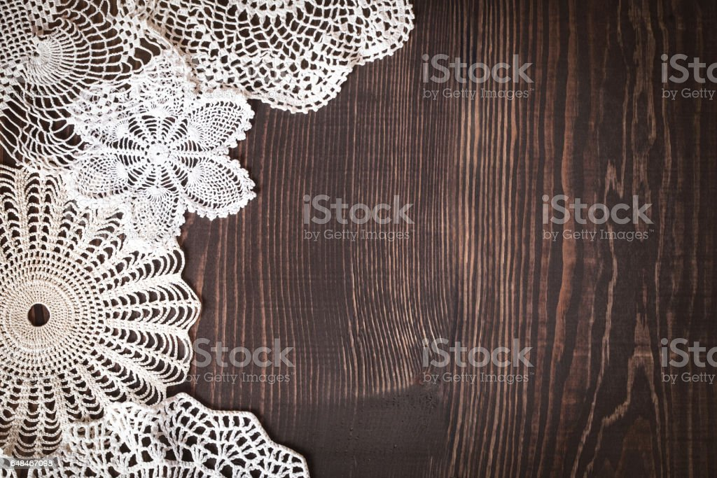 Vintage background with white crochet lace stock photo