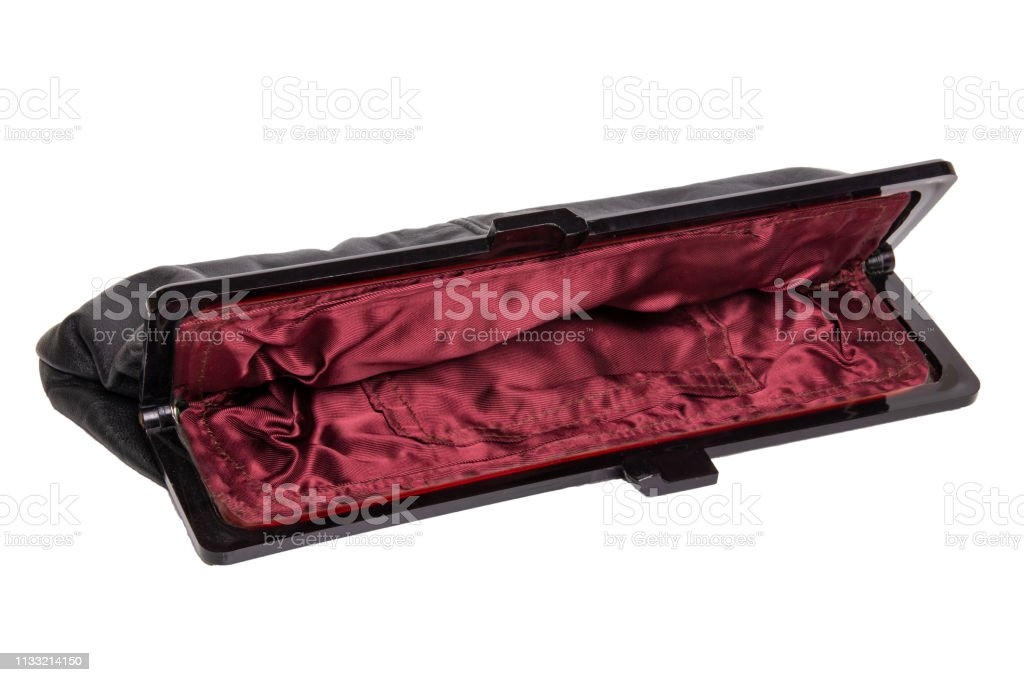 Vintage bags. A black elegant ladies handbag of the fifties isolated...