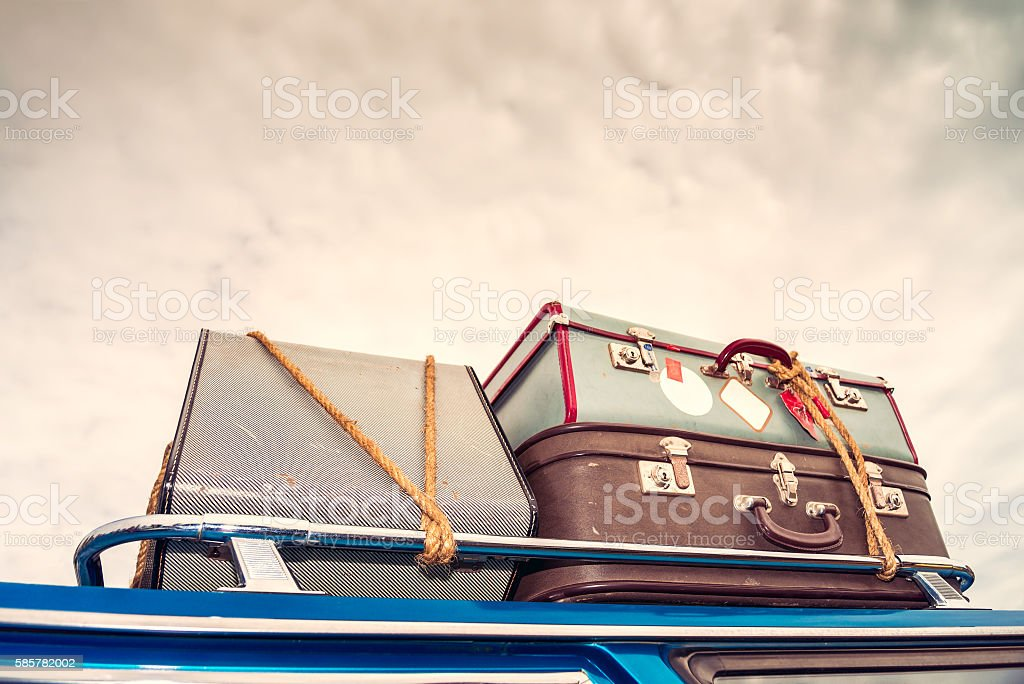Vintage bags on the car's roof stock photo